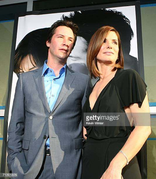 Actors Keanu Reeves and Sandra Bullock pose at the premiere of Warner Bros Pictures' The Lake House at the Cinerama Dome on June 13 2006 in Los...