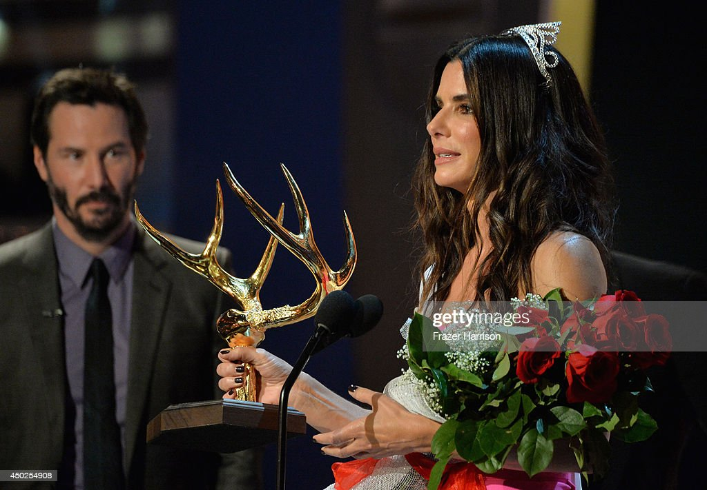 Actors Keanu Reeves (L) and Sandra Bullock speak onstage at Spike TV's 'Guys Choice 2014' at Sony Pictures Studios on June 7, 2014 in Culver City, California.