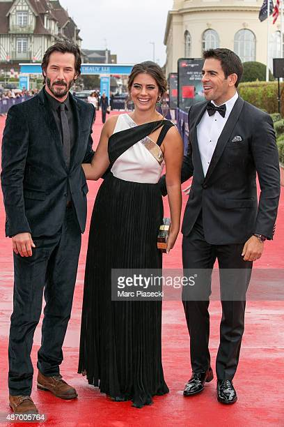 Actors Keanu Reeves Lorenza Izzo and director Eli Roth attend the 'Knock Knock' Premiere during the 41st Deauville American Film Festival on...
