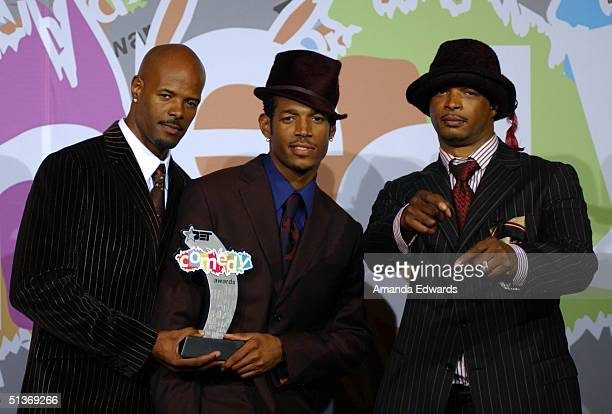 Actors Keenan Ivory Wayans Marlon Wayans and Damon Wayans pose backstage with their BET Comedy Icon Award at the FirstEver BET Comedy Awards at the...