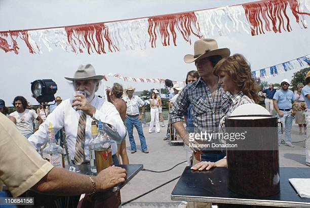 Actors Keenan Wynn Patrick Duffy and Victoria Principal on the set of the TV soap 'Dallas' 18th July 1979