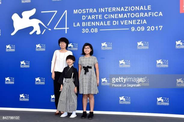 Actors Keiki Kogawa Takara Kogawa and Chisato Kogawa attend the 'The Night I Swam ' photocall during the 74th Venice Film Festival at Sala Casino on...