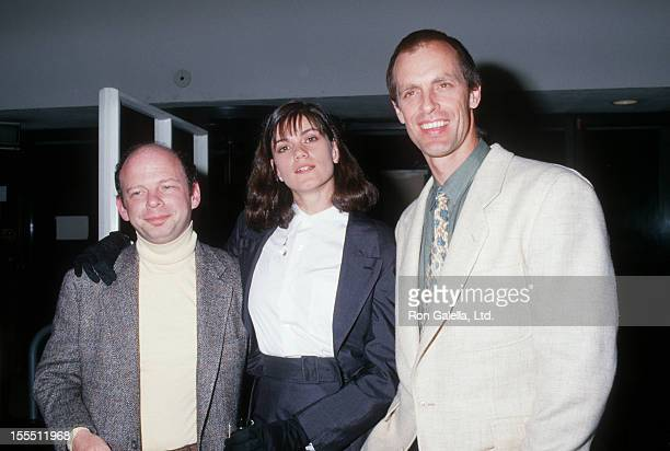 Actors Keith Carradine and Wallace Shawn and date Linda Fiorentino attending the premiere of The Moderns on April 7 1988 at Lincoln Center in New...
