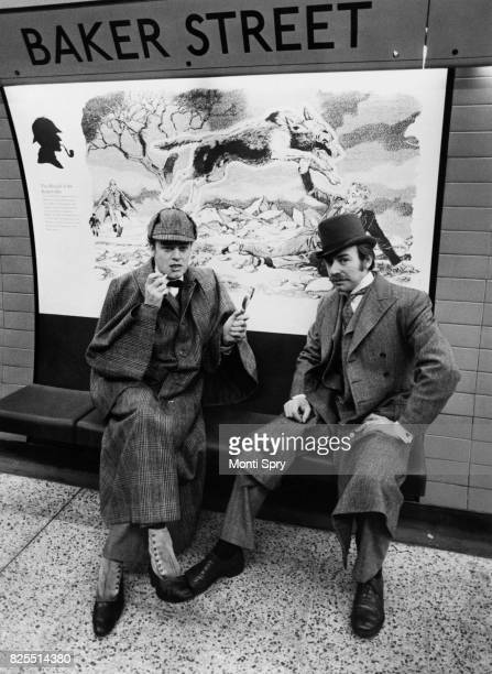 Actors Keith Mitchell and Denis Lill as Sherlock Holmes and Doctor Watson respectively posing on the new Jubilee Line platform at Baker Street...