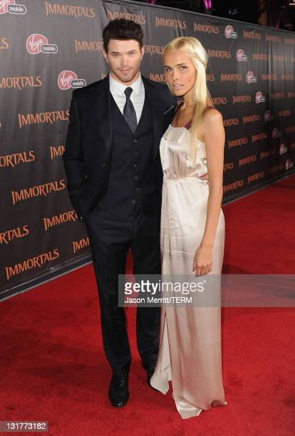 Actors Kellan Lutz and Isabel Lucas arrive at Relativity Media's Immortals premiere presented in RealD 3 at Nokia Theatre LA Live on November 7 2011...