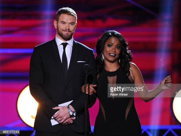 Actors Kellan Lutz and Nia Long speak onstage during the 19th Annual Critics' Choice Movie Awards at Barker Hangar on January 16 2014 in Santa Monica...
