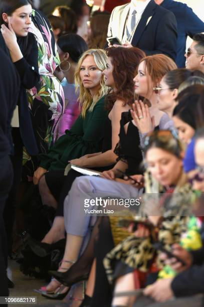 Actors Kelli Giddish and Deborah Messing attend the Christian Siriano front row during New York Fashion Week The Shows at Top of the Rock on February...