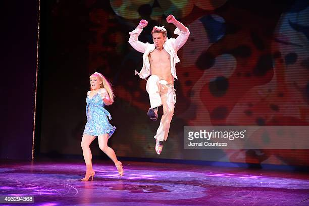 """Actors Kelly Felthous and Austin Miller perform onstage during the """"Trip of Love"""" opening night curtain call at Stage 42 on October 18, 2015 in New..."""