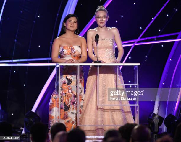 Actors Kelly Marie Tran and Dakota Fanning onstage during the 24th Annual Screen ActorsGuild Awards at The Shrine Auditorium on January 21 2018 in...