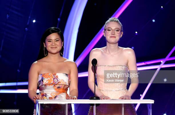 Actors Kelly Marie Tran and Dakota Fanning speak onstage during the 24th Annual Screen Actors Guild Awards at The Shrine Auditorium on January 21...