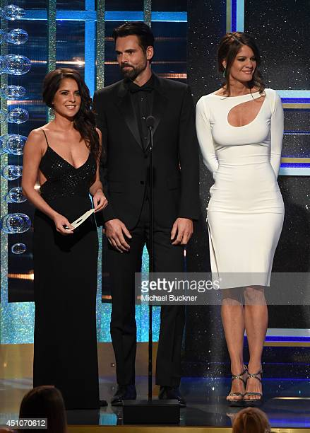 Actors Kelly Monaco Jason Thompson and Michelle Stafford speak onstage during The 41st Annual Daytime Emmy Awards at The Beverly Hilton Hotel on June...