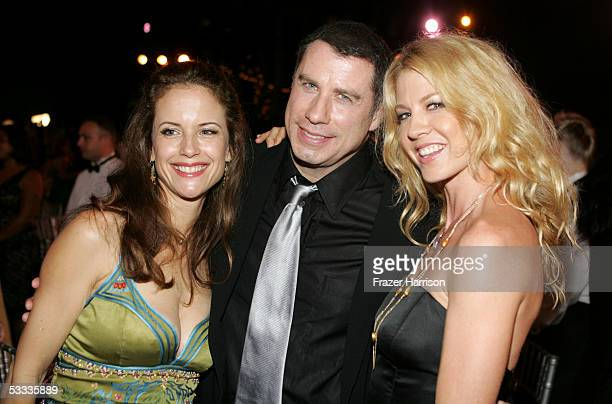 Actors Kelly Preston John Travolta and Jenna Elfman pose at the Church of Scientology Celebrity Centre 36th Anniversary Gala on August 6 2005 in...