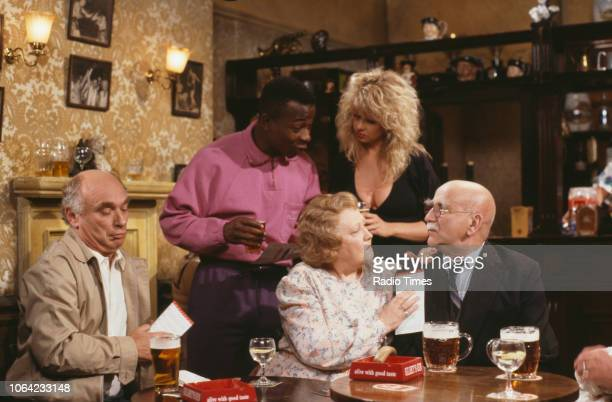 Actors Ken Campbell Vas Blackwood Corinne Russell Carmel McSharry and Warren Mitchell in a pub scene from series 4 episode 4 of the BBC television...