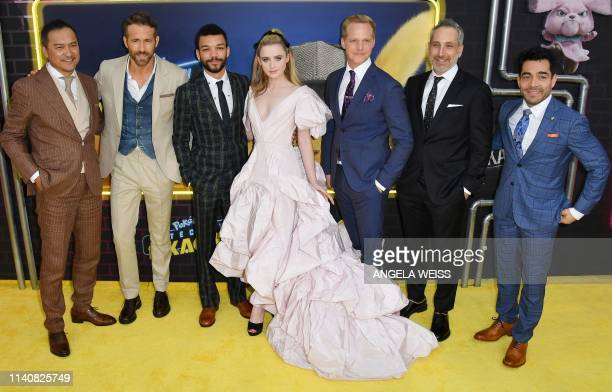 Actors Ken Watanabe Ryan Reynolds Justice Smith Kathryn Newton Chris Geere director Rob Letterman and actor Omar Chaparro attend the premiere of...