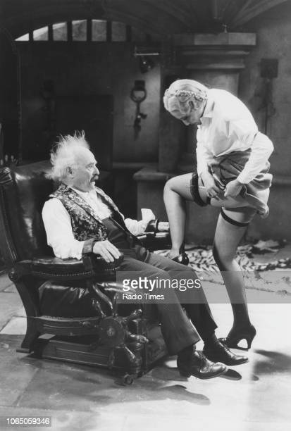Actors Kenneth Connor and Kim Hartman in a scene from episode 'The Exploding Bedpan' of the television sitcom ''Allo 'Allo' May 20th 1988