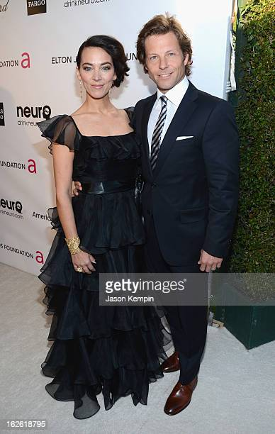 Actors Kerry Norton and Jamie Bamber attend the 21st Annual Elton John AIDS Foundation Academy Awards Viewing Party at West Hollywood Park on...