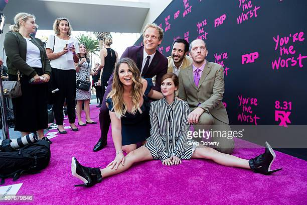 Actors Kether Donohue Chris Geere Aya Cash Desmin Borges and Producer Stephen Falkpose for a picture as they arrive for the Premiere Of FXX's You're...