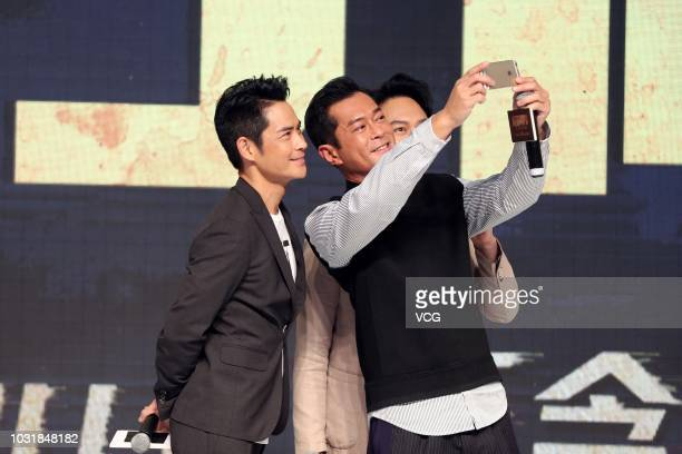 Actors Kevin Cheng Kawing Louis Koo Tinlok and Julian Cheung Chilam take a selfie during a premiere of director David Lam Takluk's film 'L Storm' on...