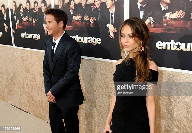 Actors Kevin Connolly and Alexis Dziena arrive on the red carpet to HBO's official premiere of Entourage Season 6 held at Paramount Studios on July 9...