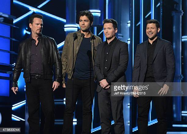 Actors Kevin Dillon Adrian Grenier Kevin Connolly and Jerry Ferrara speak onstage during the 2015 Billboard Music Awards at MGM Grand Garden Arena on...