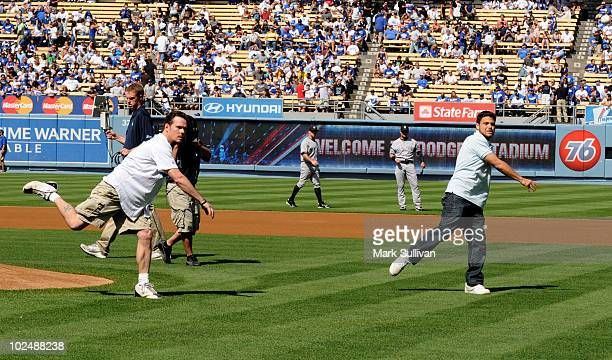 Actors Kevin Dillon and Jerry Ferrara throw out ceremonial first pitch at Dodger Stadium on June 26, 2010 in Los Angeles, California.