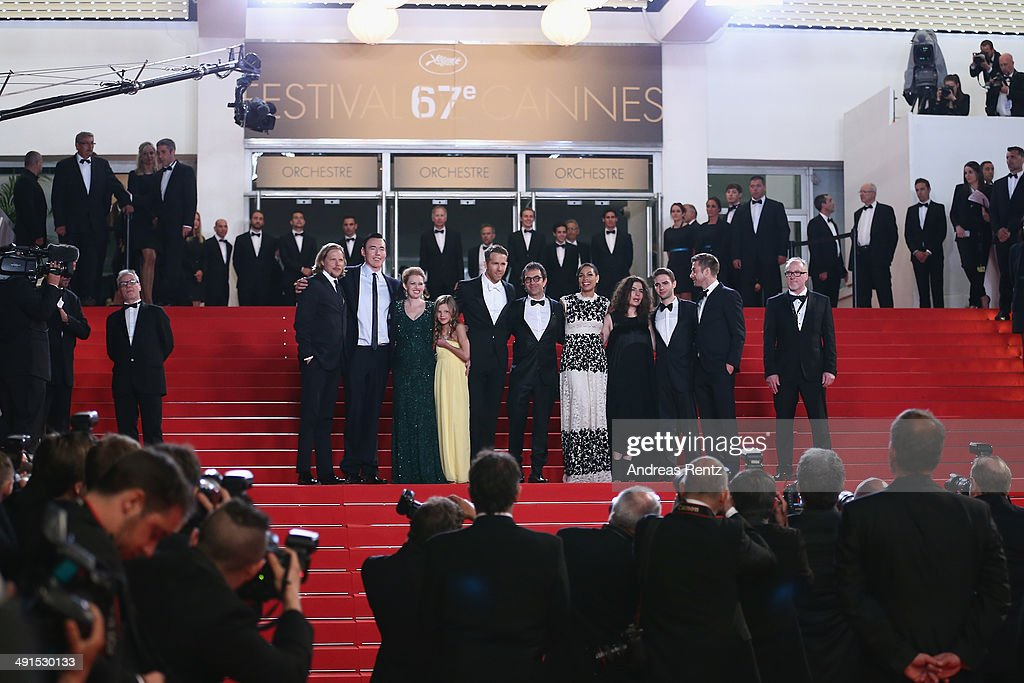 Actors Kevin Durand, Mireille Enos, Peyton Kennedy, Ryan Reynolds, director Atom Egoyan, actress Rosario Dawson, producer Arsinee Khanjian, Arshile Egoyan and actor Scott Speedman attend the 'Captives' premiere during the 67th Annual Cannes Film Festival on May 16, 2014 in Cannes, France.