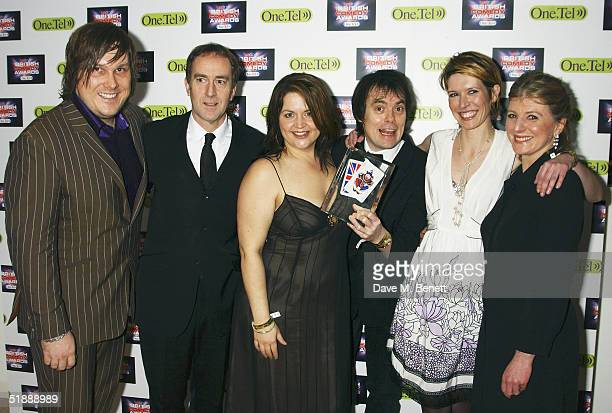 Actors Kevin Eldon Angus Deayton Ruth Jones Michael Fenton Stevens Julia Davis and Rebecca Front pose in the Awards Room with their award for Best...