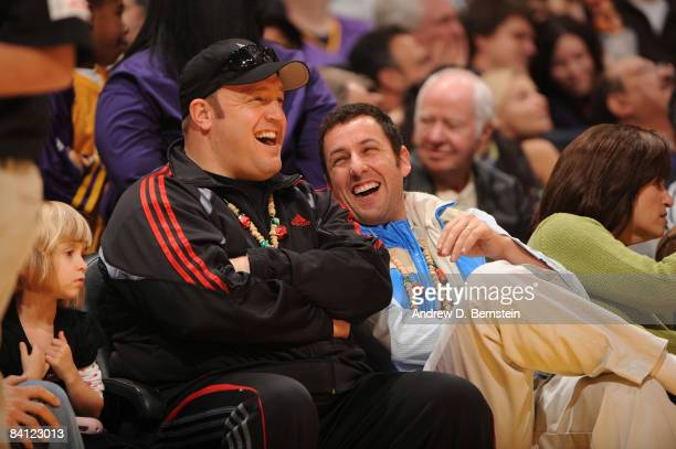 Actors Kevin James and Adam Sandler watch a game from courtside between the Boston Celtics and the Los Angeles Lakers at Staples Center on December...