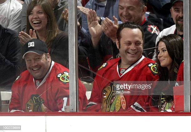 Actors Kevin James Vince Vaughn and Vaughn's wife Kyla watch the Chicago Blackhawks play the San Jose Sharks at Game Three of the Western Conference...