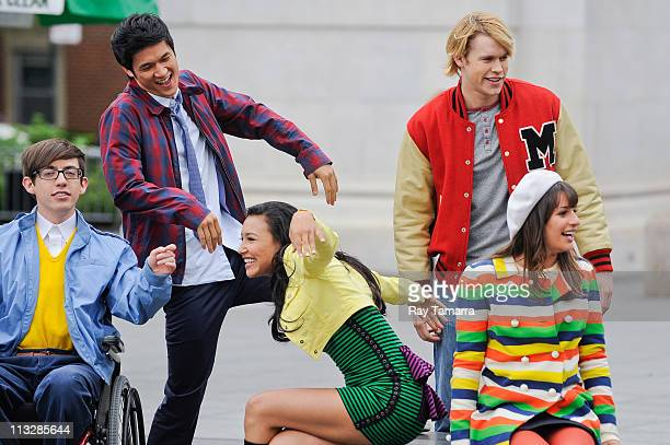 """Actors Kevin McHale, Harry Shum Jr., Naya Rivera, Chord Overstreet, and Lea Michele film a scene at the """"Glee"""" movie set in Washington Square Park on..."""