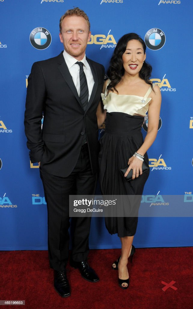 Actors Kevin McKidd and Sandra Oh arrive at the 66th Annual Directors Guild Of America Awards at the Hyatt Regency Century Plaza on January 25, 2014 in Century City, California.