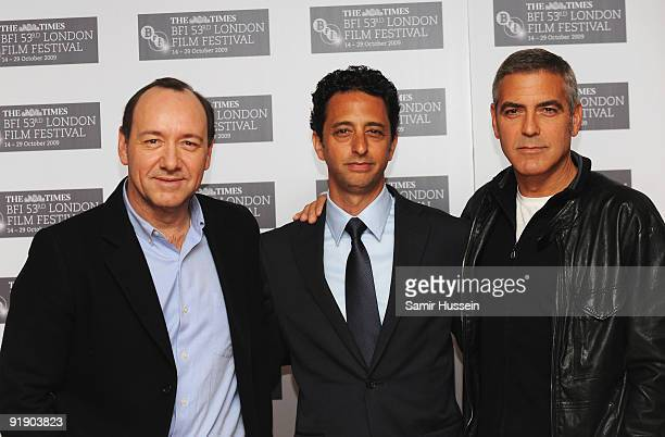 Actors Kevin Spacey and George Clooney pose with director Grant Heslov as they attend 'The Men Who Stare At Goats' photocall during the Times BFI...