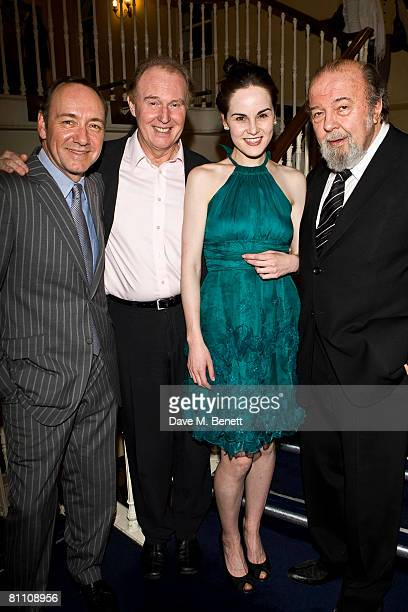 Actors Kevin Spacey Tim PigottSmith and Michelle Dockery pose with director Sir Peter Hall during the after party for the performance of 'Pygmalion'...