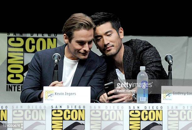 Actors Kevin Zegers and Godfrey Gao speak onstage at the Sony and Screen Gems panel for The Mortal Instruments City of Bones during ComicCon...