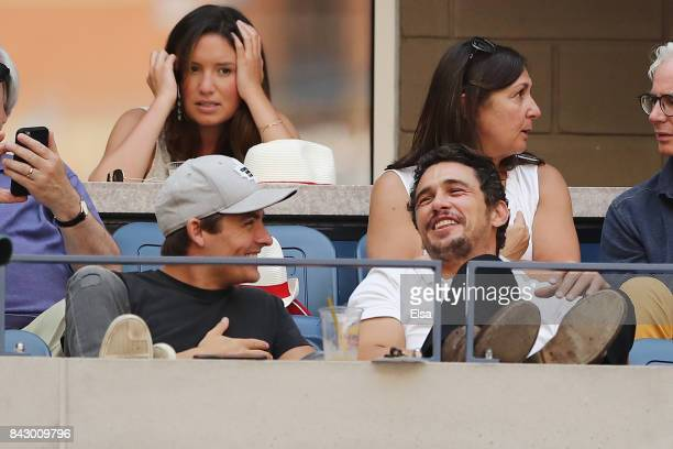 Actors Kevin Zegers and James Franco look on during the Women's Quarterfinal Match between Sloane Stephens of the United States and Anastasija...