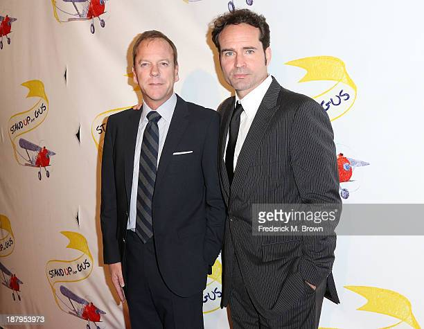 Actors Kiefer Sutherland and Jason Patric attend the 'Stand Up For Gus' Benefit at Bootsy Bellows on November 13 2013 in West Hollywood California