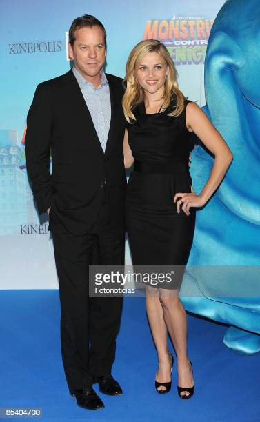 Actors Kiefer Sutherland and Reese Witherspoon arrive at the Monsters vs Aliens premiere at Kinepolis Cinema on March 12 2009 in Madrid Spain