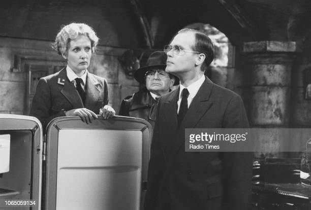 Actors Kim Hartman John Louis Mansi and Richard Gibson in a scene from the television sitcom ''Allo 'Allo' May 16th 1986