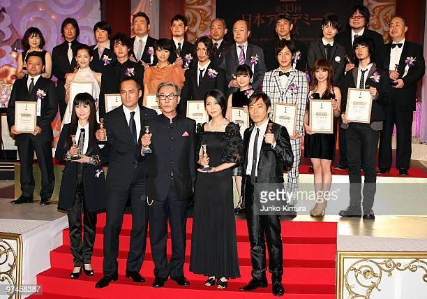 Actors Kimiko Yo Ken Watanabe director Daisaku Kimura Takako Matsu and Teruyuki Kagawa hold trophies during the 33rd Japan Academy Aawrds at Grand...