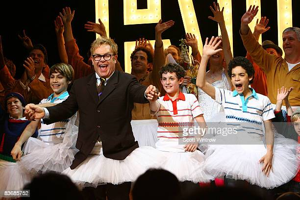 Actors Kiril Kulish musician Elton John Trent Kowalik David Alvarez and cast on stage during the curtain call for Billy Elliot The Musical on...