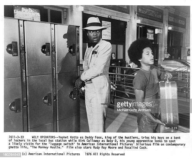 Actors Kirk Calloway and Yaphet Kotto on set for the movie The Monkey Hu$tle in 1976