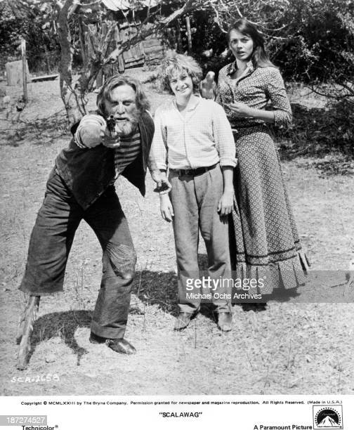 """Actors Kirk Douglas and Mark Lester with actress Lesley-Anne Down on set of the Paramount Pictures movie """"Scalawag"""" in 1973."""
