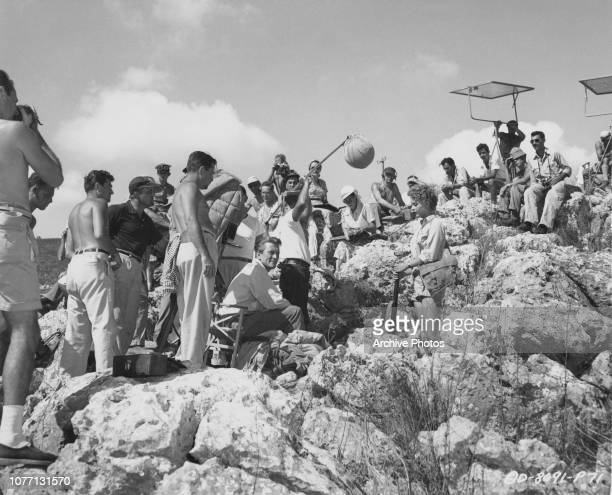 Actors Kirk Douglas and Milly Vitale filming a scene for the movie 'The Juggler' on location in Galilee, Israel, 1953. Director Edward Dmytryk is on...