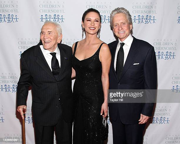 Actors Kirk Douglas, Catherine Zeta-Jones, and Michael Douglas attend the 2011 Children of Chernobyl's Children at Heart gala at the Chelsea Piers on...