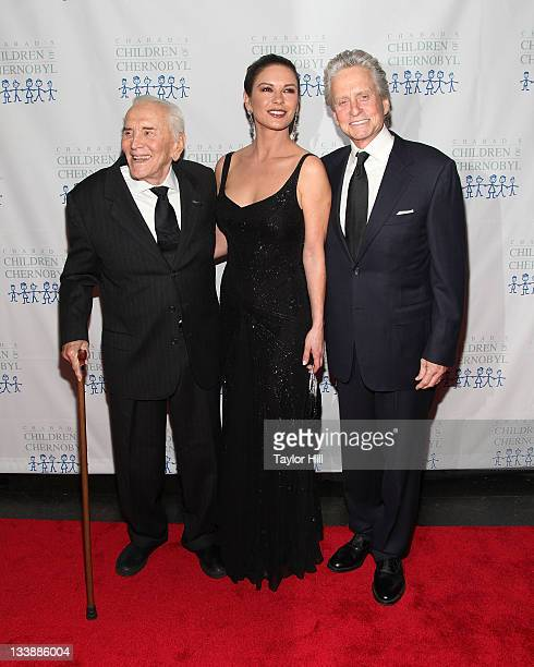 Actors Kirk Douglas Catherine ZetaJones and Michael Douglas attend the 2011 Children of Chernobyl's Children at Heart gala at the Chelsea Piers on...