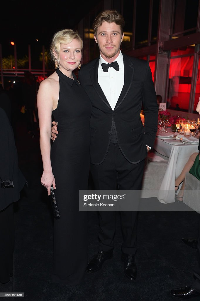 Actors Kirsten Dunst, wearing Gucci, (L) and Garrett Hedlund, wearing Gucci, attend the 2014 LACMA Art + Film Gala honoring Barbara Kruger and Quentin Tarantino presented by Gucci at LACMA on November 1, 2014 in Los Angeles, California.