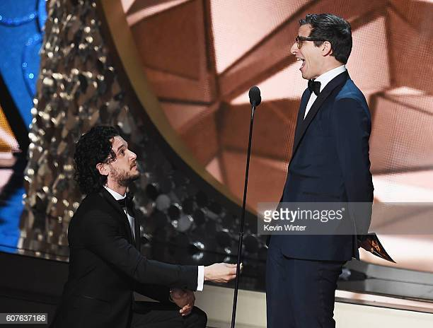 Actors Kit Harington and Andy Samberg speak onstage during the 68th Annual Primetime Emmy Awards at Microsoft Theater on September 18 2016 in Los...