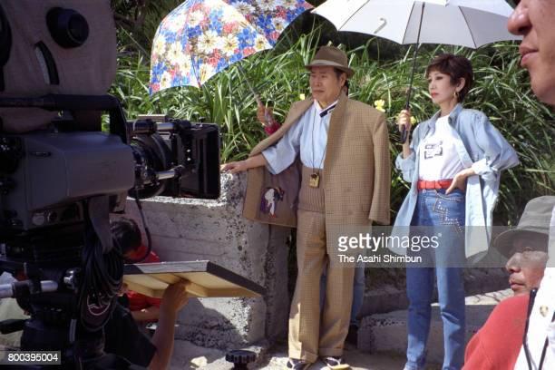 Actors Kiyoshi Atsumi and Ruriko Asaoka are seen during the movie 'OtokohaTsuraiyo' on November 9 1995 in Amami Kagoshima Japan