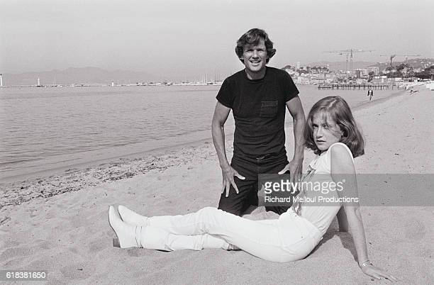 Actors Kris Kristofferson and Isabelle Huppert who star in director Michael Cimino's 1980 film Heaven's Gate relax on a beach in Cannes The film also...