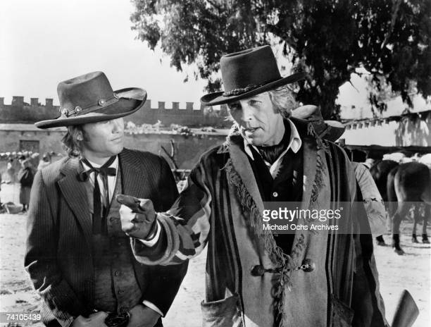 Actors Kris Kristofferson and James Coburn perform a scene in the movie Pat Garrett and Billy The Kid directed by Sam Peckinpah